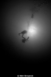 Divers on the way up from the Alma Jane. by Adam Skrzypczyk 